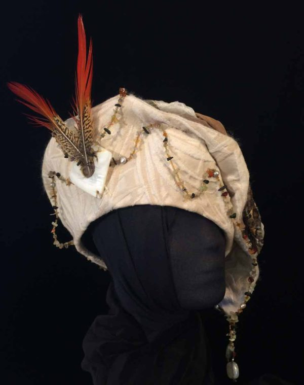 Stately Hat Features Red Pheasant Feathers Stones and Shell Adornments